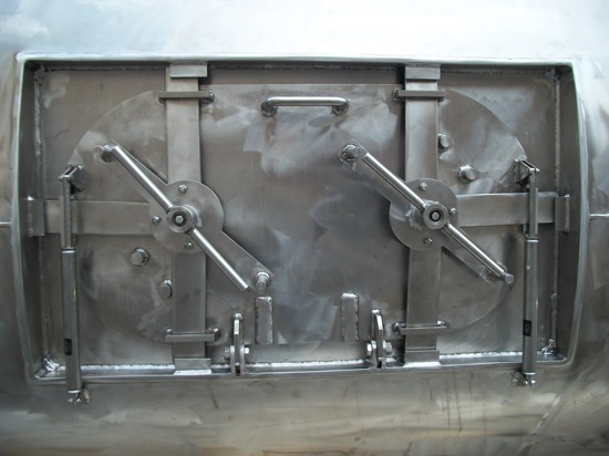 hatch doors on a stationary mixer unit
