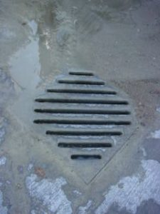 a drain at a cement truck wash