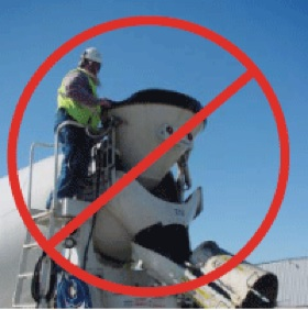 man standing at the hopper on a cement mixer with a red circle and horizontal line overlaid